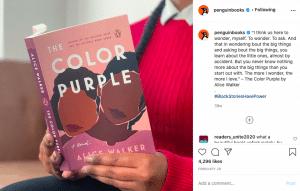 A woman reading The Color Purple, a novel.