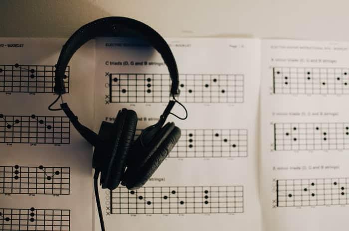 headphones over guitar chords on music sheet